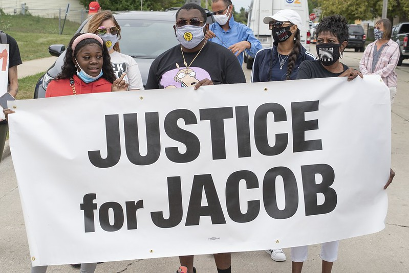 People gather last weekend at a rally for Jacob Blake, the man shot by Kenosha police on August 23.