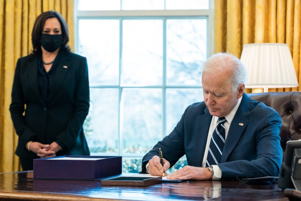 President Joe Biden signs the American Rescue Plan into law on March 11, 2021.