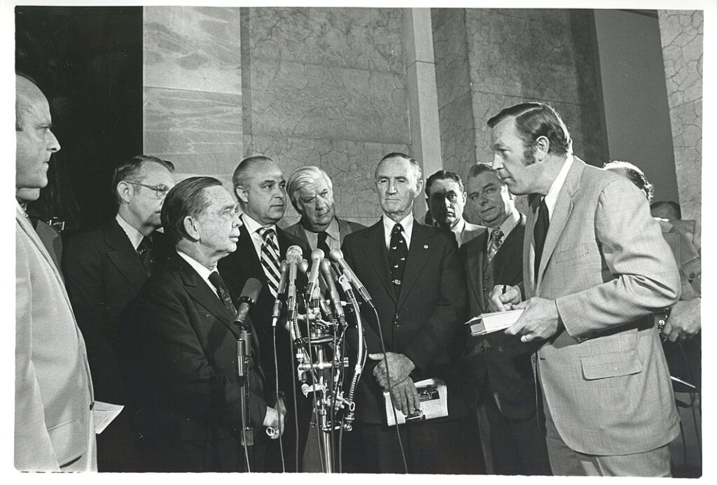 TV newsman Roger Mudd (far right) stands with a group of U.S. Congressmen.