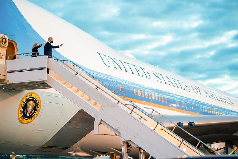 President Biden and First Lady Jill Biden wave as they board Air Force One at Royal Air Force Mildenhall, England on Wednesday, June 9, 2021.