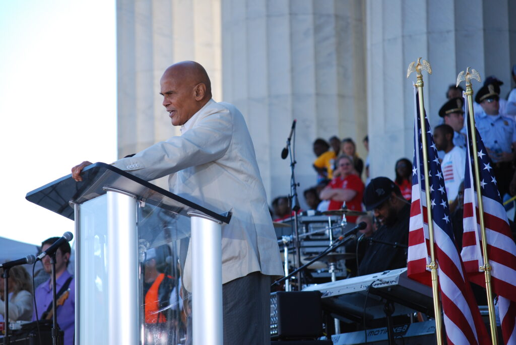 Harry Belafonte reads a speech by labor activist Cesar Chavez on the steps of the Lincoln Memorial in 2010.
