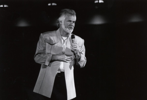 Kenny Rogers performs at a concert in 1991.