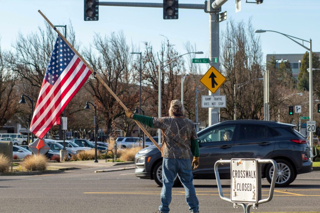 A man waves an American flag at a rally supporting President Trump on January 9, 2021.