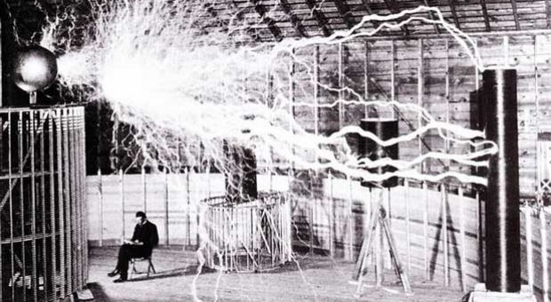 Publicity photo of Nikola Tesla sitting in his laboratory in Colorado Springs in December 1899. Tesla's notes identify the photo as a double exposure. Photo by Dickenson V. Alley of Century Magazines.