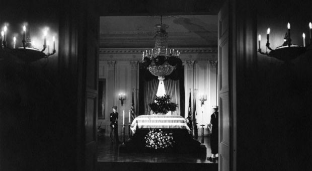 President John F. Kennedy's flag-draped casket lies in state in the East Room of the White House, Washington, D.C. Two members of the honor guard attend the casket.