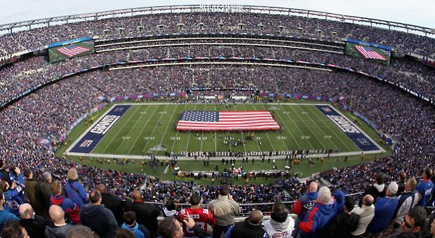A general view of a giant American Flag stretched across the field during the performcance of the National Anthem prior to the New York Giants hosting the Atlanta Falcons during their NFC Wild Card Playoff game at MetLife Stadium on January 8, 2012 in East Rutherford, New Jersey.