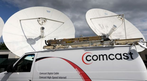 A Comcast truck is seen parked at one of their centers on Feb. 13, 2014 in Pompano Beach, Fla. Comcast announced a $45 billion offer for Time Warner Cable on Feb. 14, 2014.
