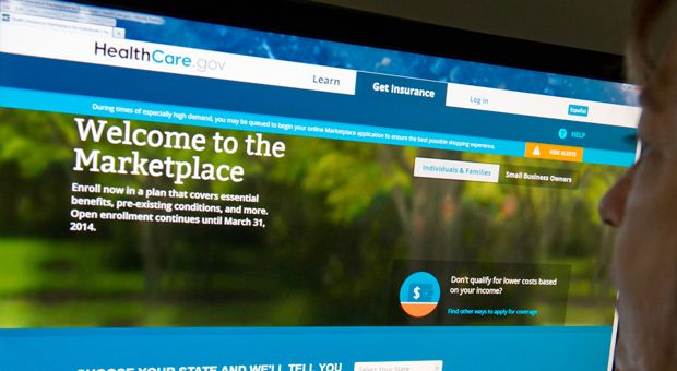 This December 2, 2013 photo shows a woman reading the HealthCare.gov insurance marketplace internet site in Washington, D.C.  This week, two U.S appeals courts issued conflicting rulings on whether millions who buy health insurance on federally run health exchanges can get subsidies.