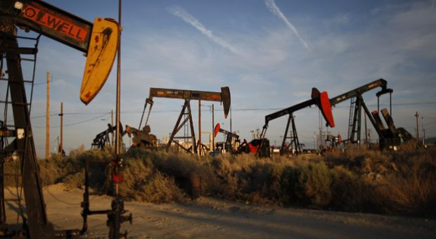 Pump jacks and wells are seen in an oil field on the Monterey Shale formation where gas and oil extraction using hydraulic fracturing, or fracking, is on the verge of a boom near McKittrick, California.