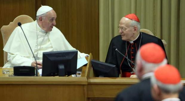 Pope Francis chats with Ungarian cardinal and archbisop of Budapest cardinal Peter Erdo (R) as he arrives at the Synod Hall for the Synod on the themes of family on October 6, 2014 in Vatican City, Vatican. Pope Francis addressed the Fathers of the Extraordinary Assembly of the Synod of Bishops on Monday, as they began their first full day of sessions exploring the pastoral challenges of the family in the context of evangelization.