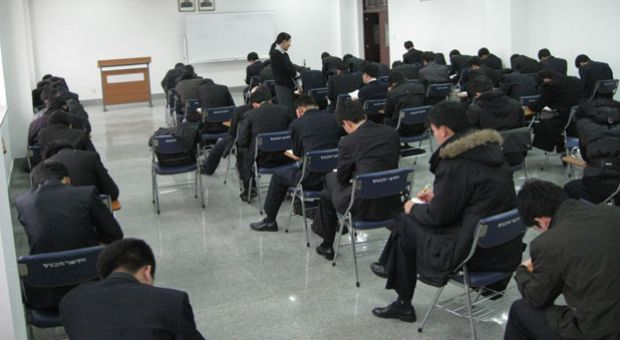 Suki Kim and her students take a final exam at a school in North Korea, December 2011.
