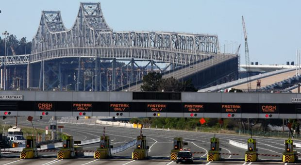 A California Highway Patrol officer guards the closed toll plaza leading to the San Francisco Bay Bridge October 28, 2009 in Oakland, California.