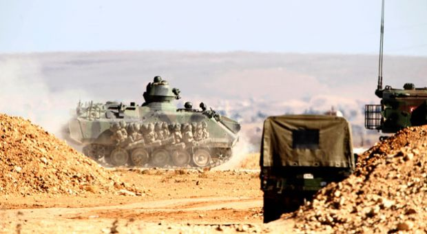 Turkish forces tanks and armored vehicles patrol the Turkish-Syrian border October 20, 2014 in the southeastern town of Suruc in Sanliurfa province, Turkey.