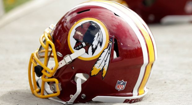 Washington Redskins helmets lay on the ground during the team's game against the Oakland Raiders at O.co Coliseum on September 29, 2013 in Oakland, California.