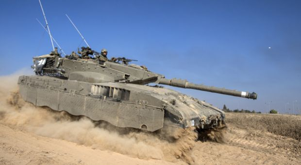 An Israeli Merkava tank rolls near the Israeli-Gaza Strip border, on July 21, 2014. US Secretary of State John Kerry is to push for an immediate ceasefire in Gaza when he arrives Monday in Cairo, President Barack Obama said.