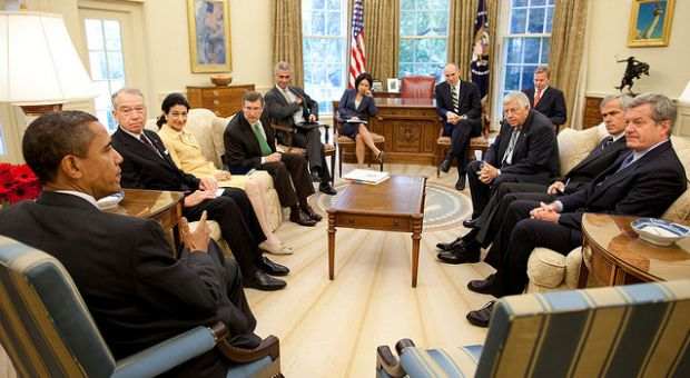 President Barrack Obama meets in the Oval Office with members of the Senate Finance Committee on Aug. 6, 2009