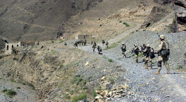 Soldiers from B Company 2-187 Infantry 101st Airborne Division (Air Assault) perform their sensitive sites exploitation (SSE) in an Afghan village near the Pakistan border (2002)