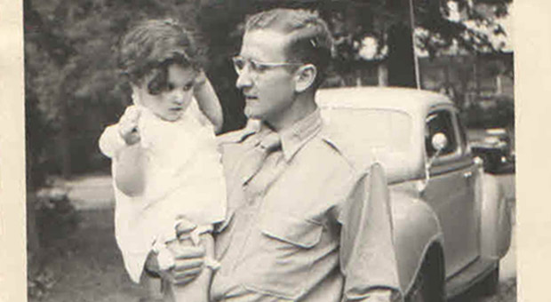 Ellen Feldman being held by her Uncle Sina Baum, a captain in the Army Medical Corp during WW II.