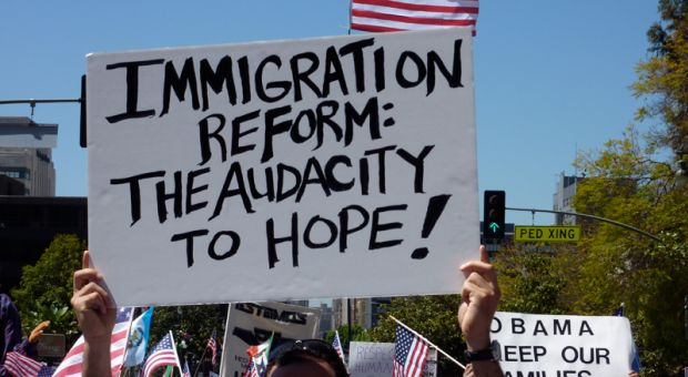 Signs at a May 2010 immigration reform rally in Los Angeles, CA