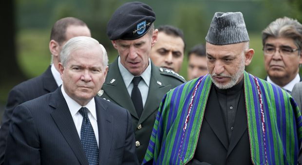 From left, Secretary of Defense Robert M. Gates and Gen. Stanley McChrystal, commander of NATO's International Security Assistance Force, escort Afghan President Hamid Karzai on a tour of Arlington National Cemetery's Section 60 May 13, 2010.