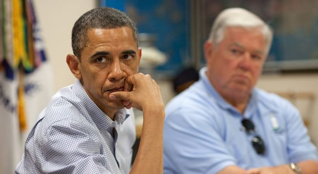 President Barack Obama listens during a briefing about the ongoing response to the BP oil spill, at the Gulfport Coast Guard Station in Gulfport, Miss., June 14, 2010. Mississippi Gov. Haley Barbour is seated at right.